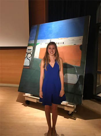 Katherine Van Kirk, '19, with the Diebenkorn painting Window, which she examined in her investigative project.