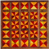 Hand-carved wooden quilts by artists Fraser Smith and Fay Jean Hooker combine with antique fabric quilts from the collection of Gerald E. Roy